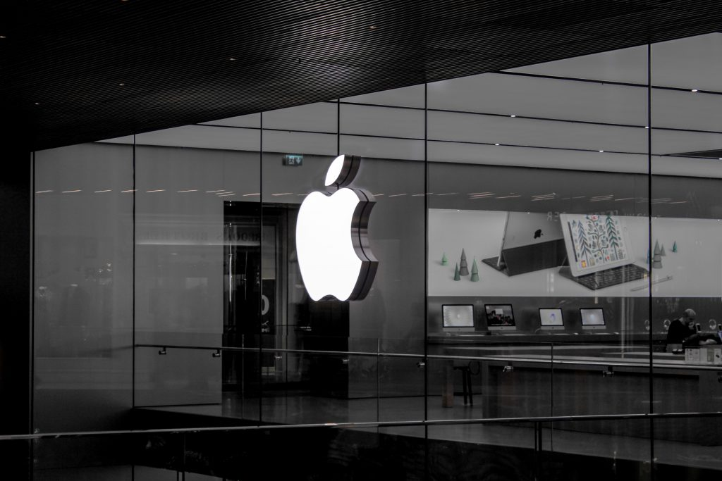Monochrome photo of Apple logo in a dim lit office