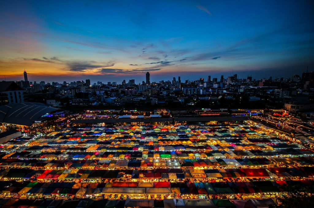 A lit up market after the sunset