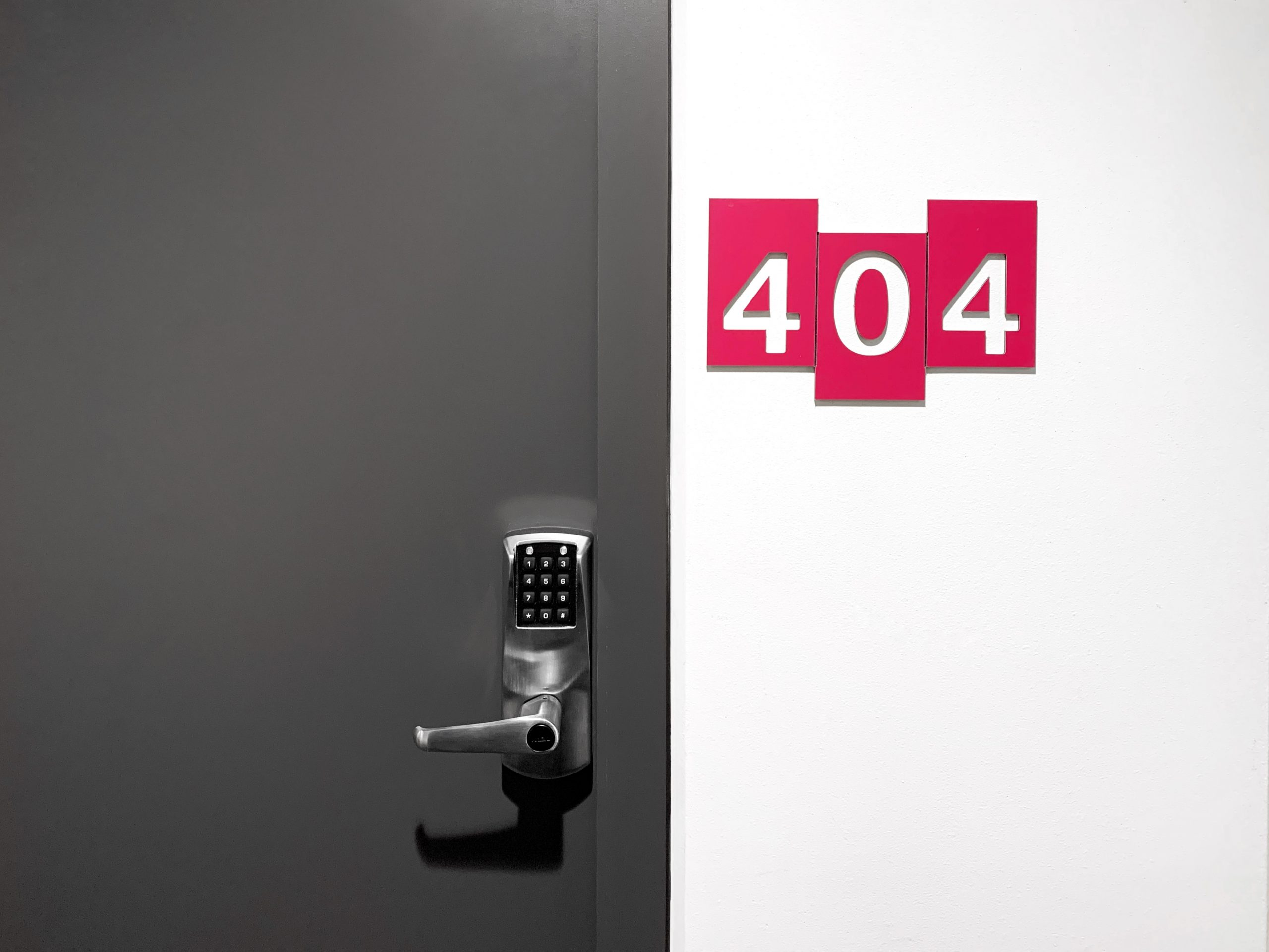 Door with 404 sign on the wall
