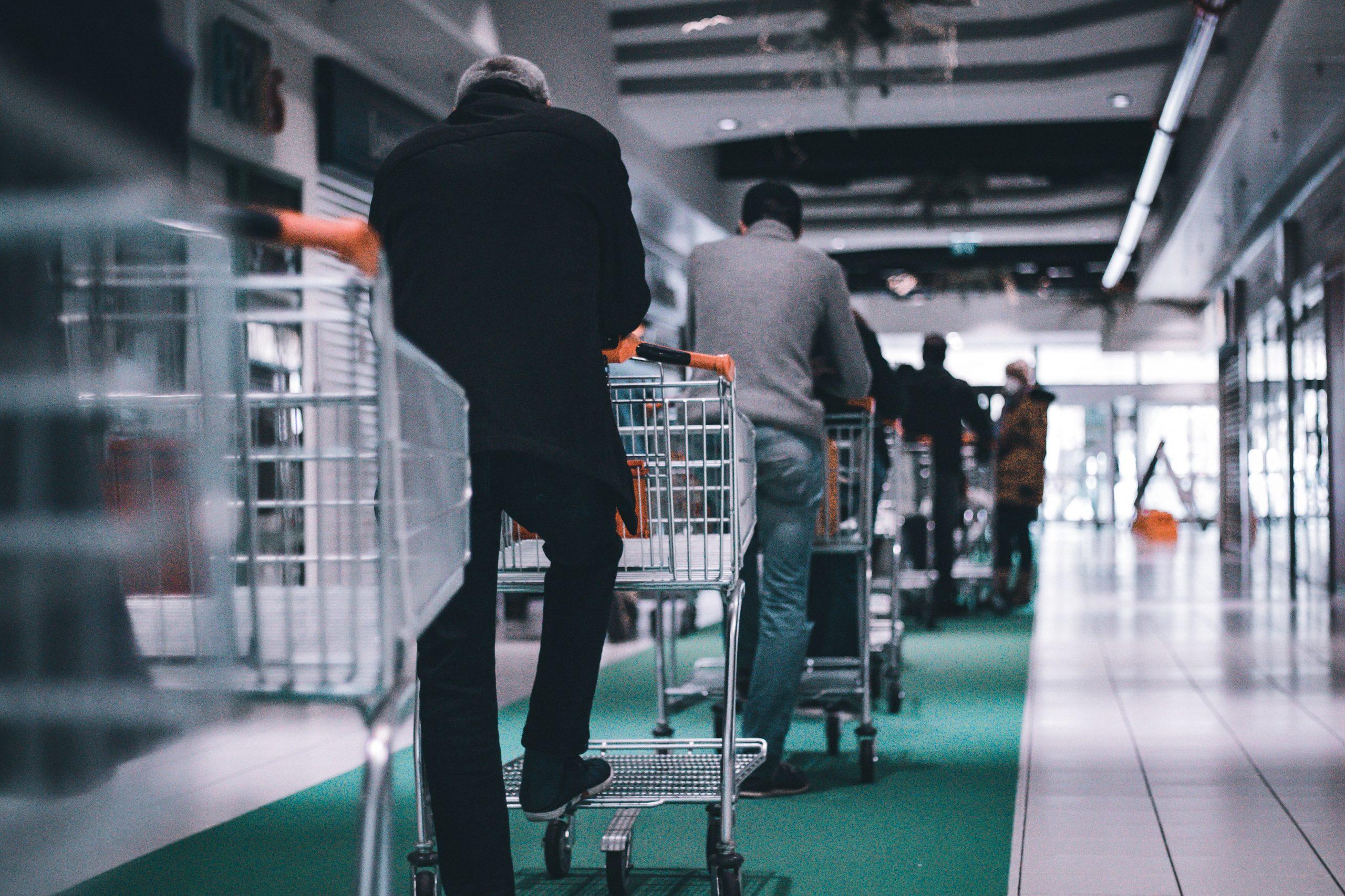 person pushing shopping carts