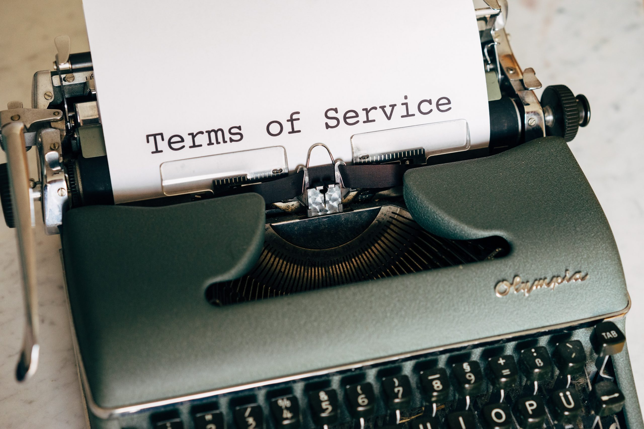 Typewriter with a page with term of service written on it