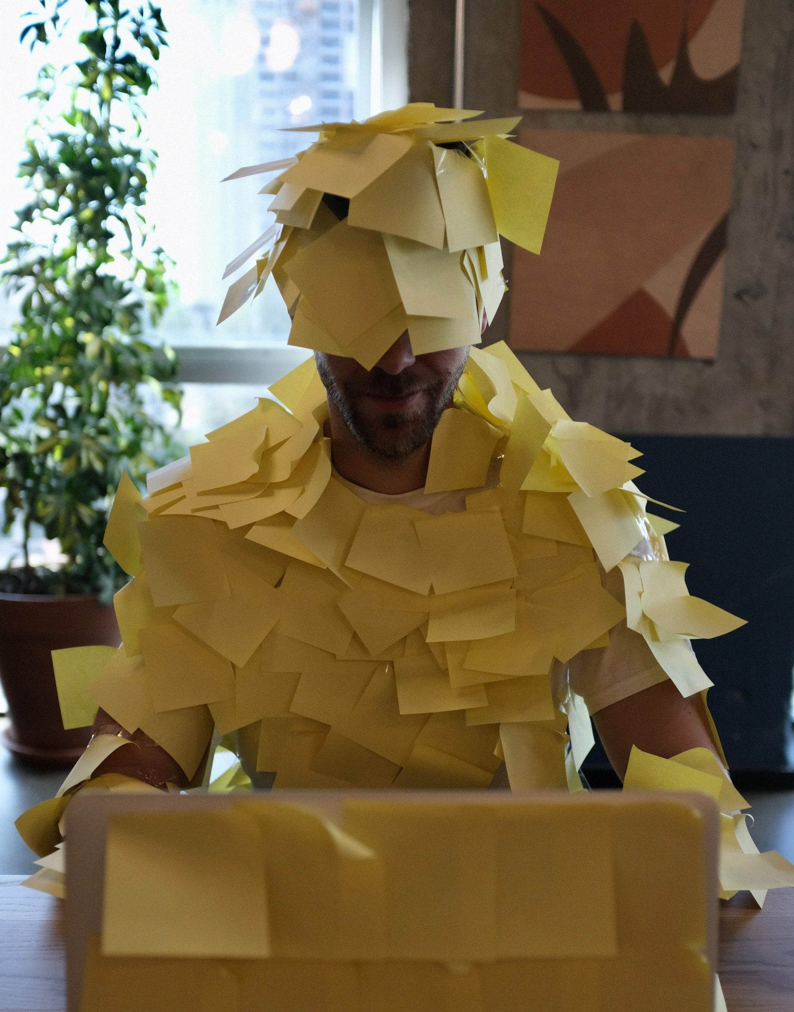 A person covered in sticky notes